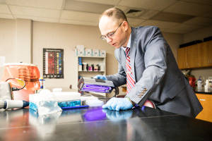 Dr. Jason Marion working in a lab
